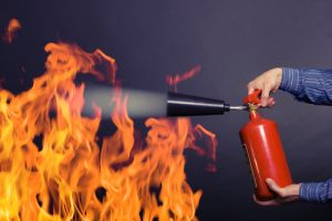 man with extinguisher fighting a fire-img-blog