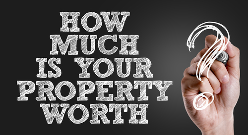 Hand writing the text- How Much Is Your Property Worth-img-blog