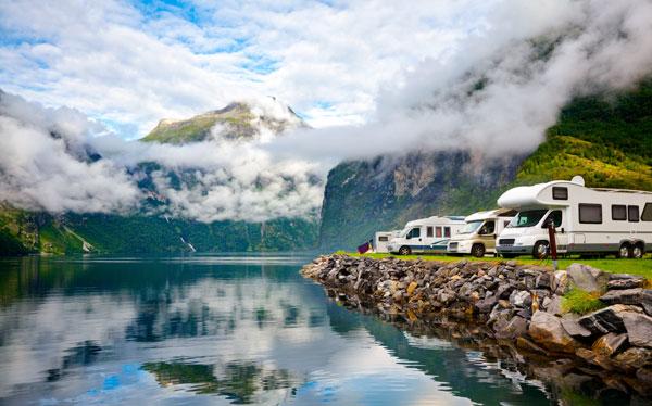 RCamper van recreational vehicles (RV) parked at norwegian campsite on a fjord coast, Norway, Scandinavia