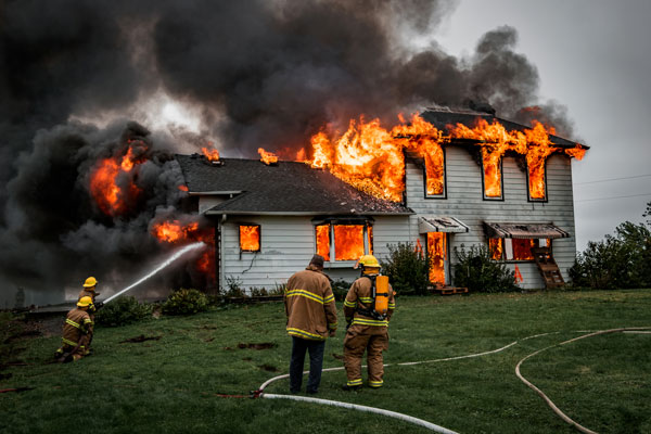 Firefighters putting out a house fire.