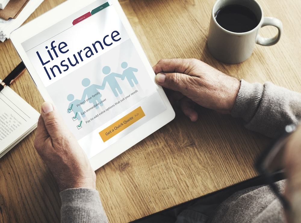 A person holding their life insurance policy.