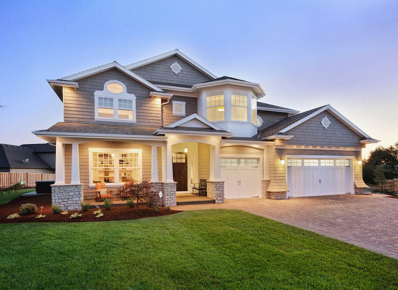 Beautiful family home with wood siding and manicured lawn.