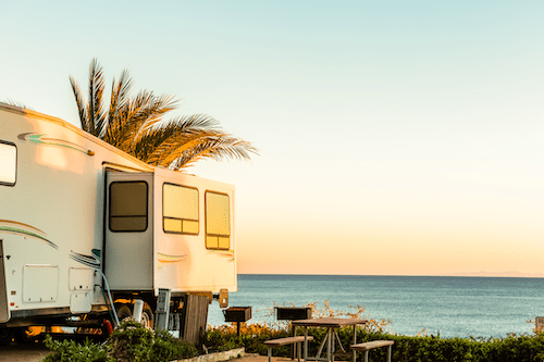 RV camper parked at the beach